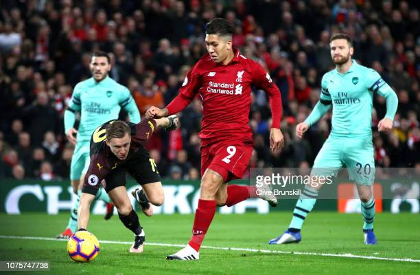 Roberto Firmino of Liverpool scores his sides first goal during the Premier League match between Liverpool FC and Arsenal FC at Anfield on December...