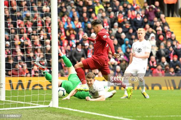 Roberto Firmino of Liverpool scores his sides first goal during the Premier League match between Liverpool FC and Burnley FC at Anfield on March 10...