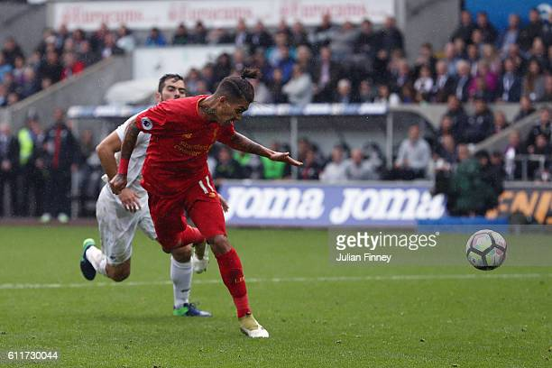 Roberto Firmino of Liverpool scores his sides first goal during the Premier League match between Swansea City and Liverpool at Liberty Stadium on...