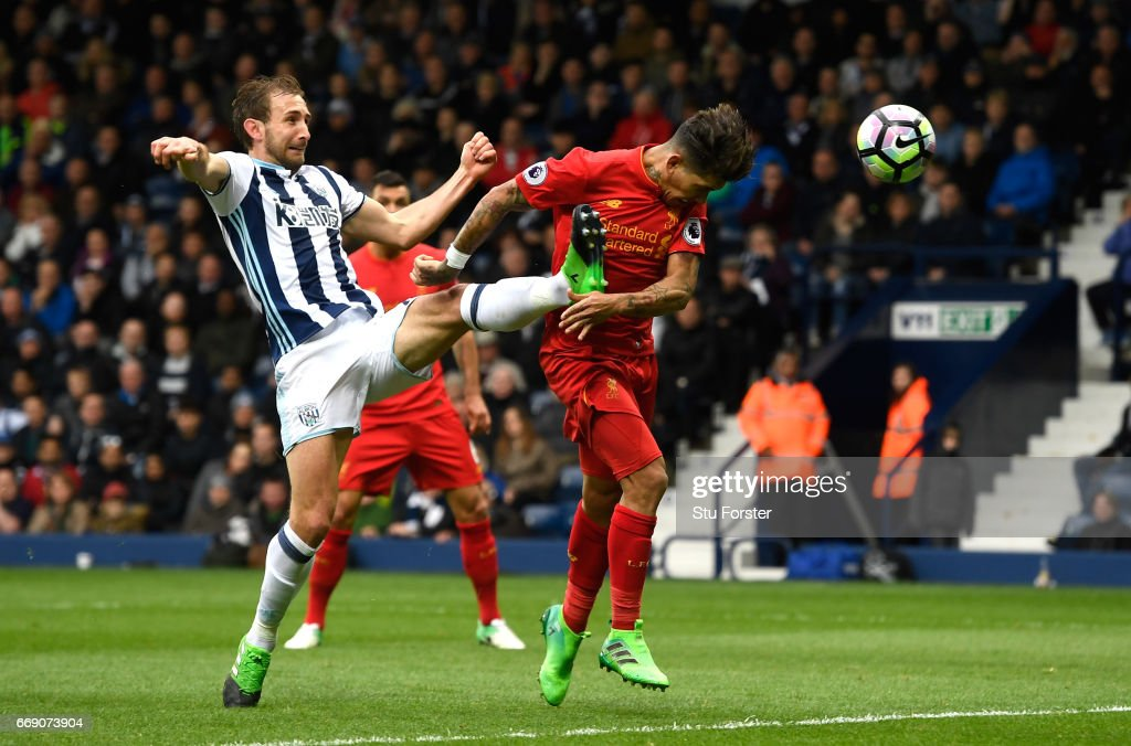 Roberto Firmino of Liverpool scores his sides first goal during the Premier League match between West Bromwich Albion and Liverpool at The Hawthorns on April 16, 2017 in West Bromwich, England.