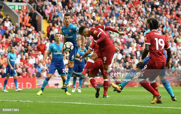 Roberto Firmino of Liverpool scores his sides first goal during the Premier League match between Liverpool and Arsenal at Anfield on August 27 2017...