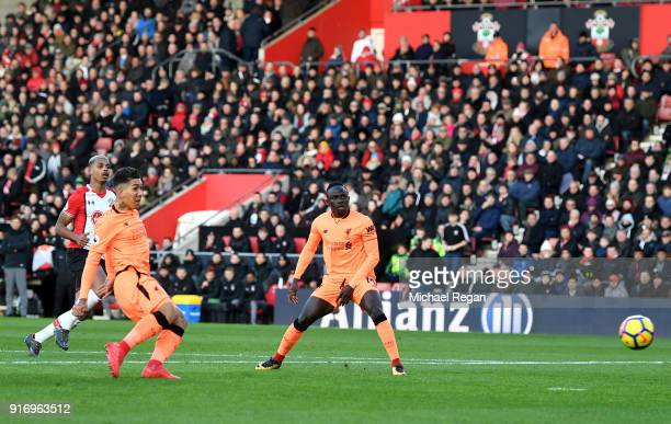 Roberto Firmino of Liverpool scores his sides first goal during the Premier League match between Southampton and Liverpool at St Mary's Stadium on...