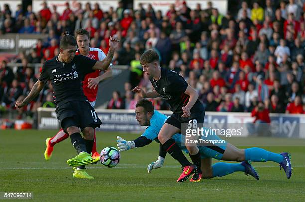 Roberto Firmino of Liverpool scores his sides fourth goal during the PreSeason Friendly match between Fleetwood Town and Liverpool at Highbury...
