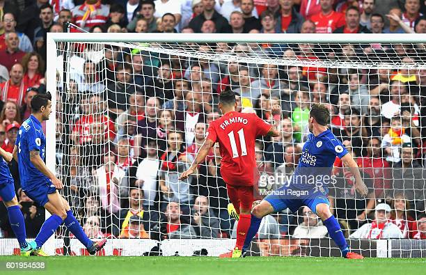 Roberto Firmino of Liverpool scores his sides fourth goal during the Premier League match between Liverpool and Leicester City at Anfield on...