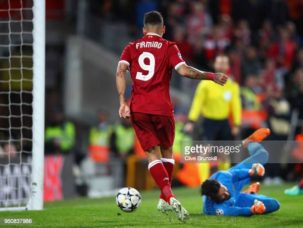 Roberto Firmino of Liverpool scores his sides fourth goal past Alisson Becker of AS Roma during the UEFA Champions League Semi Final First Leg match...