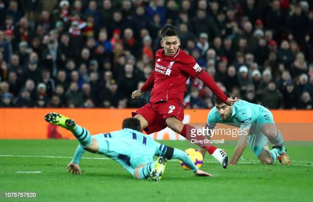 Roberto Firmino of Liverpool scores his sides second goal during the Premier League match between Liverpool FC and Arsenal FC at Anfield on December...