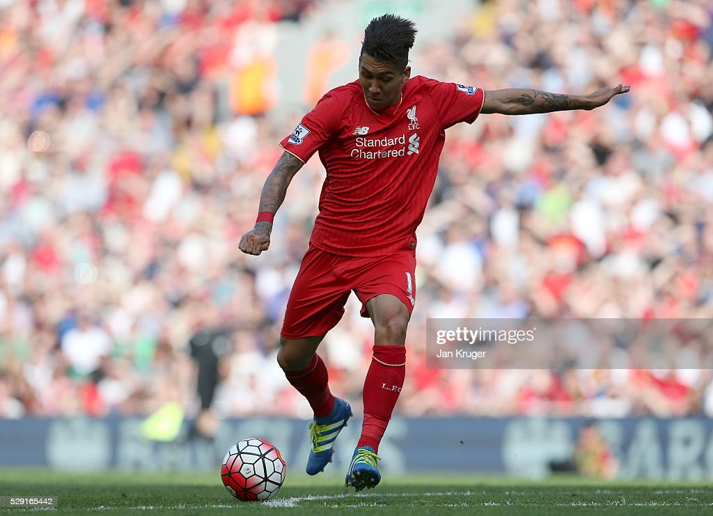 Roberto Firmino of Liverpool scores his side's second goal during the Barclays Premier League match between Liverpool and Watford at Anfield on May 8, 2016 in Liverpool, England.