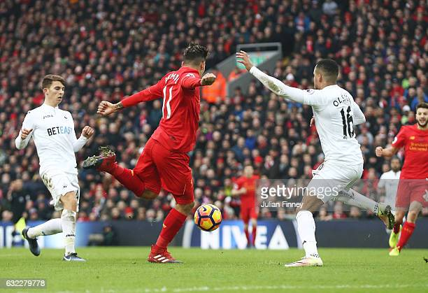 Roberto Firmino of Liverpool scores his sides second goal during the Premier League match between Liverpool and Swansea City at Anfield on January 21...