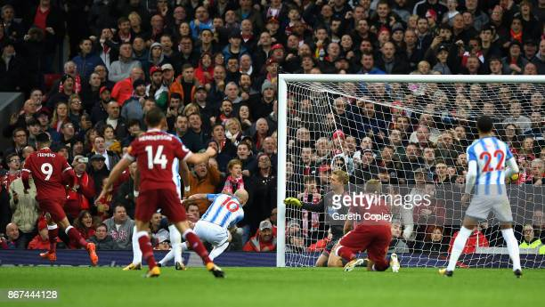 Roberto Firmino of Liverpool scores his sides second goal during the Premier League match between Liverpool and Huddersfield Town at Anfield on...