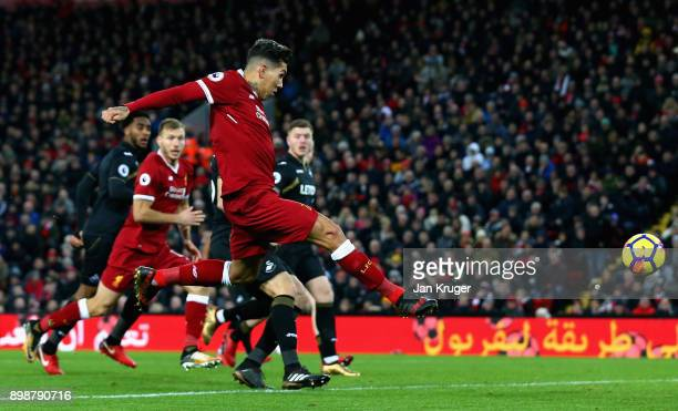 Roberto Firmino of Liverpool scores his sides second goal during the Premier League match between Liverpool and Swansea City at Anfield on December...