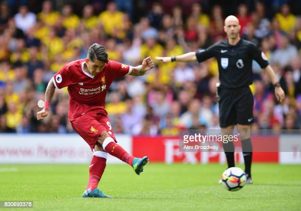 Roberto Firmino of Liverpool scores his sides second goal from the penalty spot during the Premier League match between Watford and Liverpool at...