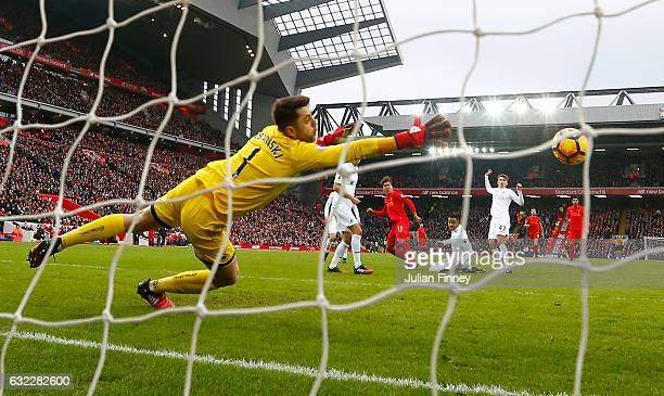 Roberto Firmino of Liverpool scores his sides second goal past Lukasz Fabianski of Swansea City during the Premier League match between Liverpool and...