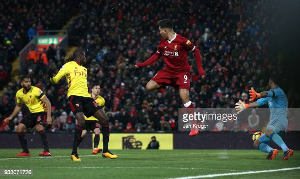 Roberto Firmino of Liverpool scores his side's third goal during the Premier League match between Liverpool and Watford at Anfield on March 17 2018...