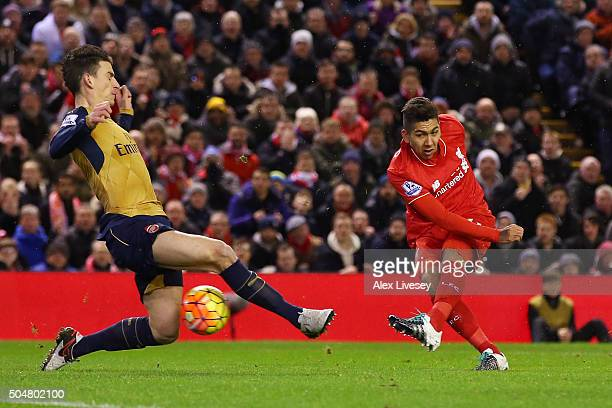 Roberto Firmino of Liverpool scores his team's first goal during the Barclays Premier League match between Liverpool and Arsenal at Anfield on...