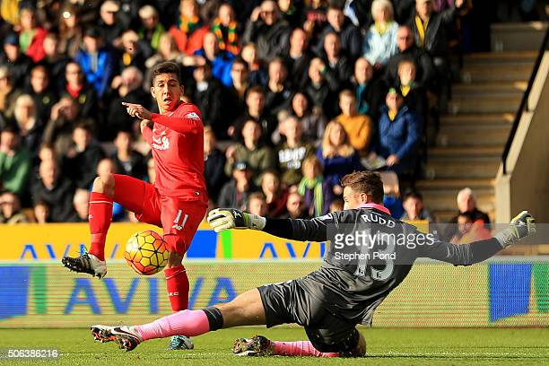 Roberto Firmino of Liverpool scores his team's first goal past Declan Rudd of Norwich City during the Barclays Premier League match between Norwich...