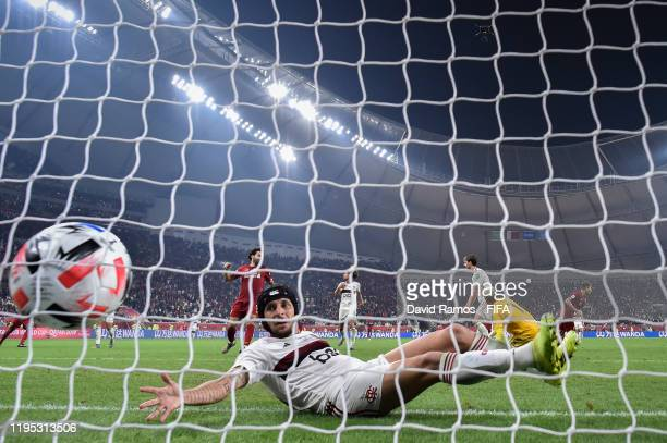 Roberto Firmino of Liverpool scores his team's first goal past Rafinha of CR Flamengo during the FIFA Club World Cup Qatar 2019 Final match between...