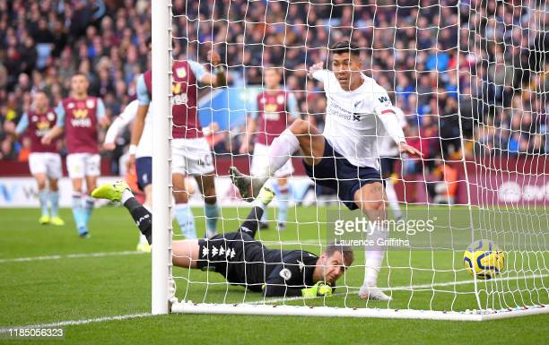 Roberto Firmino of Liverpool scores his team's first goal which is then disallowed during the Premier League match between Aston Villa and Liverpool...