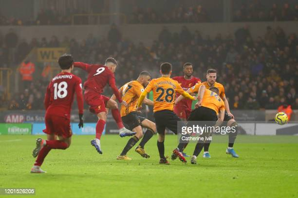 Roberto Firmino of Liverpool scores his team's second goal during the Premier League match between Wolverhampton Wanderers and Liverpool FC at...