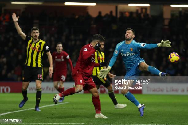 Roberto Firmino of Liverpool scores his team's third goal during the Premier League match between Watford FC and Liverpool FC at Vicarage Road on...
