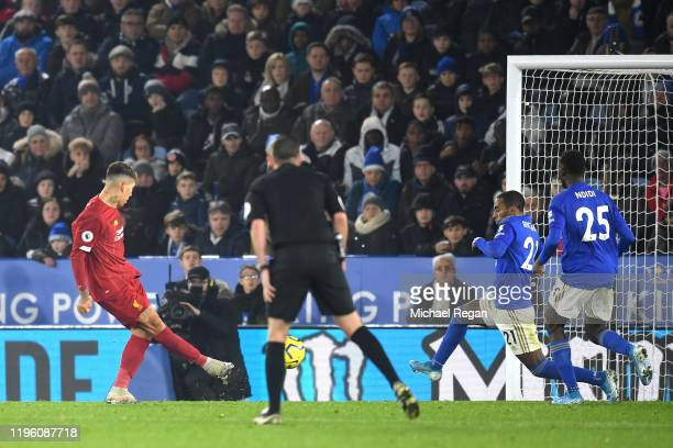 Roberto Firmino of Liverpool scores his team's third goal during the Premier League match between Leicester City and Liverpool FC at The King Power...
