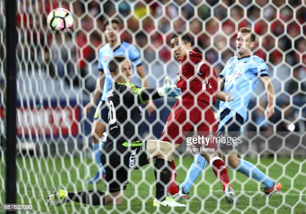 Roberto Firmino of Liverpool scores his teams third goal past Danny Vukovic of Sydney FC during the International Friendly match between Sydney FC...