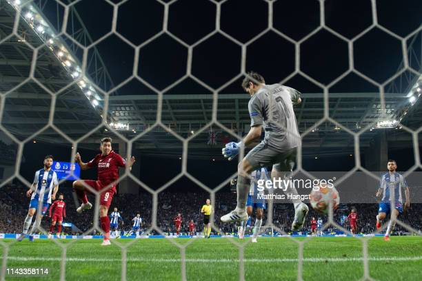 Roberto Firmino of Liverpool scores his team's third goal past Iker Casillas of FC Porto during the UEFA Champions League Quarter Final second leg...