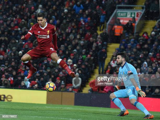 Roberto Firmino of Liverpool Scores thde third Goal during the Premier League match between Liverpool and Watford at Anfield on March 17 2018 in...