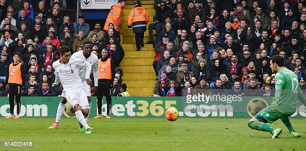 Roberto Firmino of Liverpool scores the equalising goal during the Barclays Premier League match between Crystal Palace and Liverpool at Selhurst...