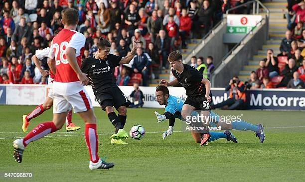 Roberto Firmino of Liverpool scores the fourth goal during the PreSeason Friendly match bewteen Fleetwood Town and Liverpool at Highbury Stadium on...