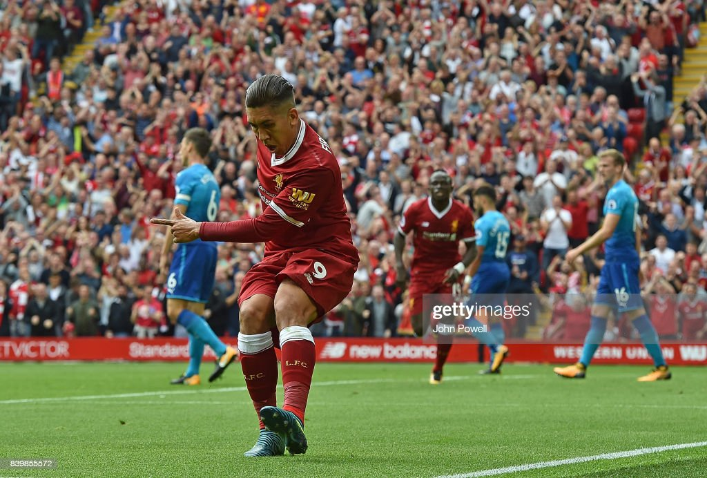 Roberto Firmino of Liverpool scores the opener and celebrates during the Premier League match between Liverpool and Arsenal at Anfield on August 27, 2017 in Liverpool, England.
