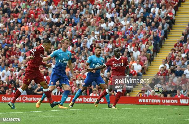 Roberto Firmino of Liverpool scores the opener during the Premier League match between Liverpool and Arsenal at Anfield on August 27 2017 in...