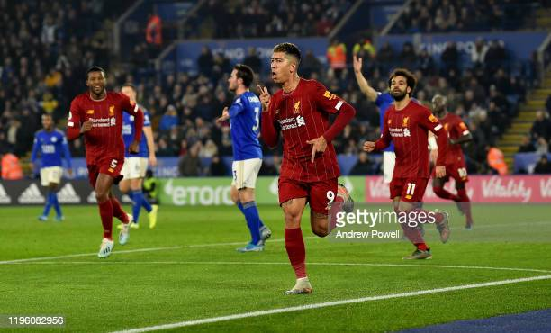 Roberto Firmino of Liverpool scores the opening goal and celebrates during the Premier League match between Leicester City and Liverpool FC at The...