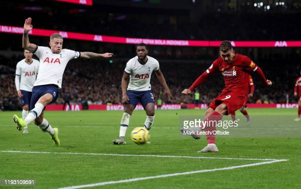 Roberto Firmino of Liverpool scores the opening goal as Toby Alderweireld of Tottenham fails to block the shot during the Premier League match...