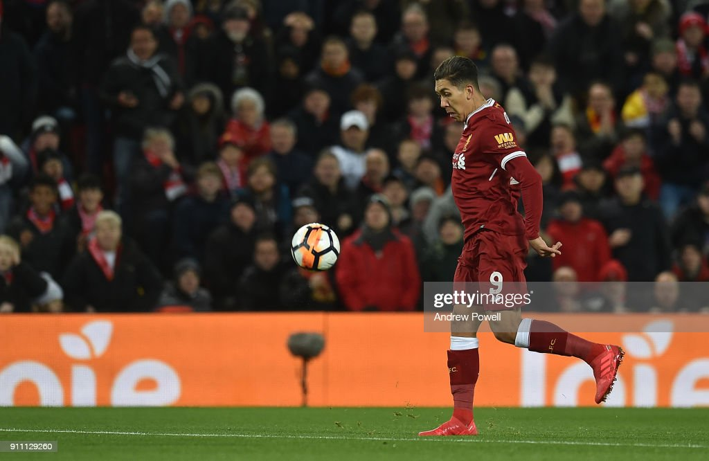 Roberto Firmino of Liverpool scores the opening goal during The Emirates FA Cup Fourth Round match between Liverpool and West Bromwich Albion at Anfield on January 27, 2018 in Liverpool, England.