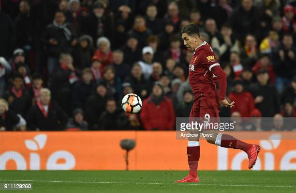 Roberto Firmino of Liverpool scores the opening goal during The Emirates FA Cup Fourth Round match between Liverpool and West Bromwich Albion at...