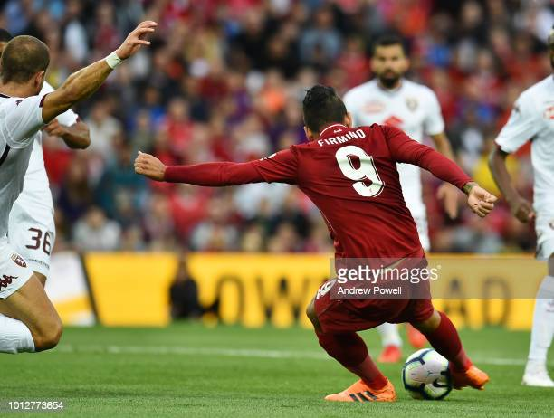 Roberto Firmino of Liverpool scores the opening goal during the PreSeason friendly match between Liverpool and Torino at Anfield on August 7 2018 in...