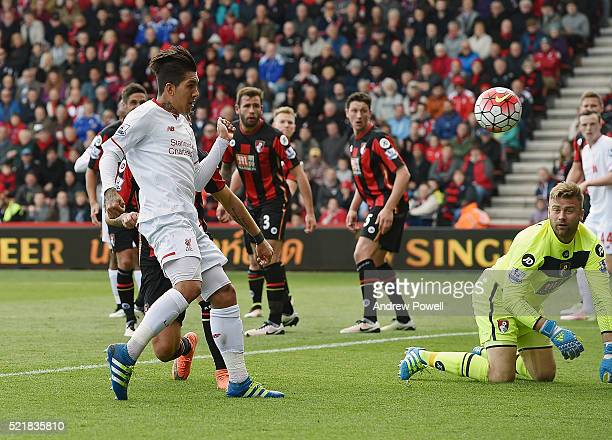Roberto Firmino of Liverpool scores the opening goal during the Barclays Premier League match between A.F.C. Bournemouth and Liverpool at Vitality...