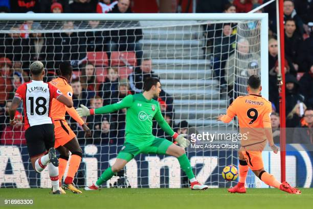 Roberto Firmino of Liverpool scores the opening goal during the Premier League match between Southampton and Liverpool at St Mary's Stadium on...