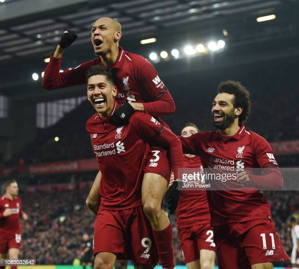 Roberto Firmino of Liverpool scores the Second goal and celebrates during the Premier League match between Liverpool FC and Crystal Palace at Anfield...