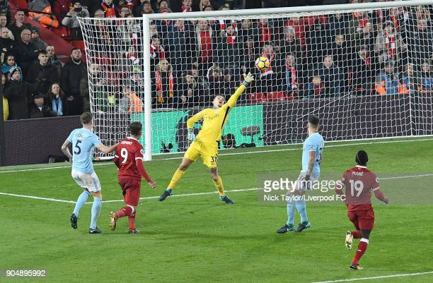 Roberto Firmino of Liverpool Scores the second goalduring the Premier League match between Liverpool and Manchester City at Anfield on January 14...