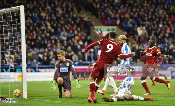 Roberto Firmino of Liverpool scores the second goal during the Premier League match between Huddersfield Town and Liverpool at John Smith's Stadium...