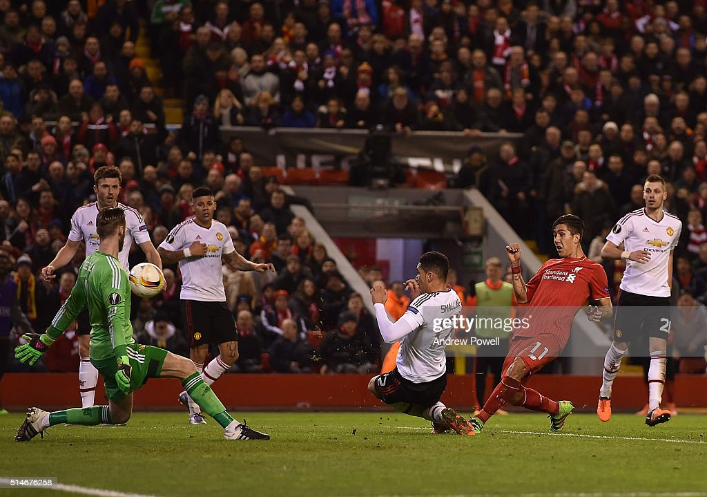 Roberto Firmino of Liverpool scores the second goal during the UEFA Europa League Round of 16: first leg match between Liverpool and Manchester United on March 10, 2016 in Liverpool, United Kingdom.