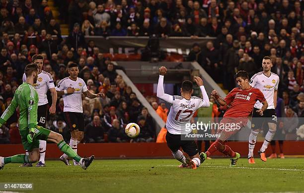 Roberto Firmino of Liverpool scores the second goal during the UEFA Europa League Round of 16 first leg match between Liverpool and Manchester United...