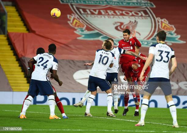 Roberto Firmino of Liverpool scores the second goal making the score 2-1 during the Premier League match between Liverpool and Tottenham Hotspur at...