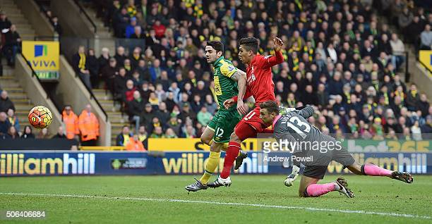 Roberto Firmino of Liverpool scores the third and equalising goal during the Barclays Premier League match between Norwich City and Liverpool at...