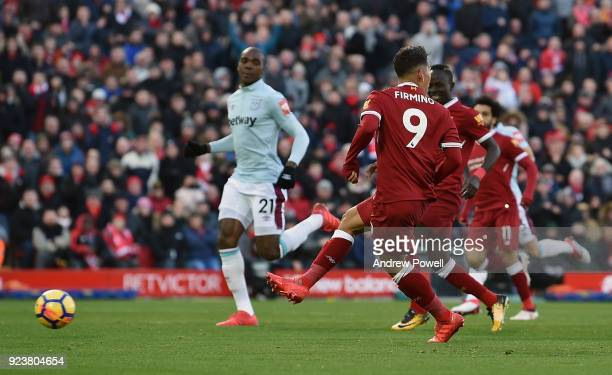 Roberto Firmino of Liverpool scores the third goal during the Premier League match between Liverpool and West Ham United at Anfield on February 24...