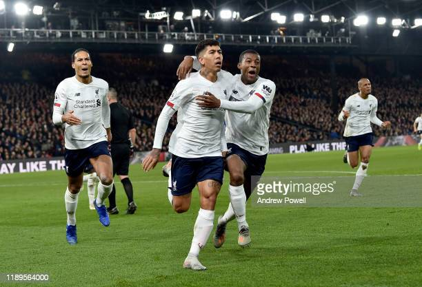 Roberto Firmino of Liverpool scores the winning goal and Celebrates during the Premier League match between Crystal Palace and Liverpool FC at...