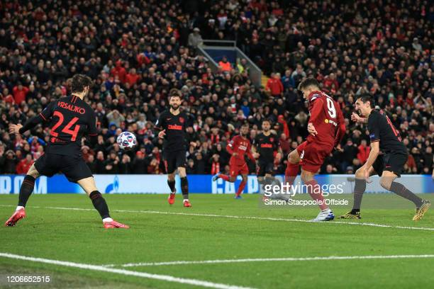 Roberto Firmino of Liverpool scores their 2nd goal during the UEFA Champions League round of 16 second leg match between Liverpool FC and Atletico...