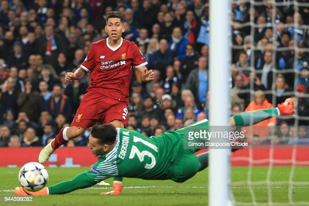 Roberto Firmino of Liverpool scores their 2nd goal during the UEFA Champions League Quarter Final Second Leg match between Manchester City and...