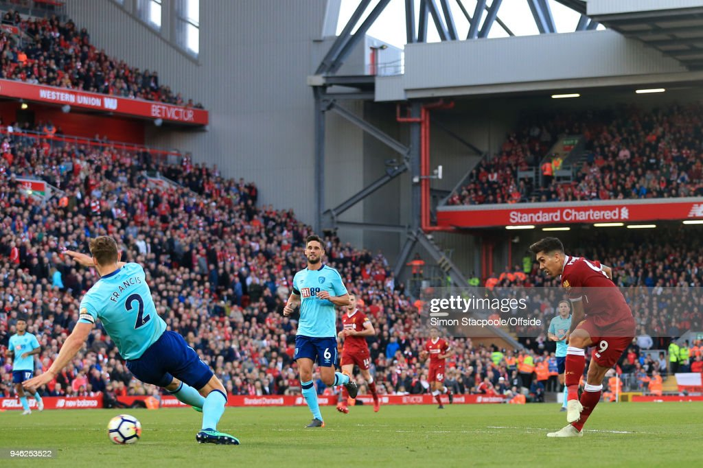 Roberto Firmino of Liverpool scores their 3rd goal during the Premier League match between Liverpool and AFC Bournemouth at Anfield on April 14, 2018 in Liverpool, England.
